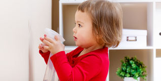 Toddler girl helping clean the house Stock Photography