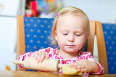 Toddler girl helping at kitchen Royalty Free Stock Photography