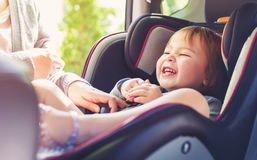 Toddler girl in her car seat Stock Photo