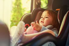 Toddler girl in her car seat Stock Photography