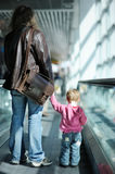 Toddler girl and her father on an escalator Stock Photos