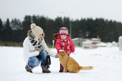 Toddler girl and her mother on a winter day Royalty Free Stock Photography