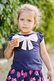 Toddler girl with an ice cream royalty free stock images