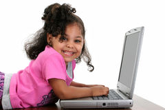 Toddler Girl In Pink With Laptop Stock Photo