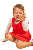 Toddler girl laughing out loud. Toddler girl sitting down and laughing out loud  and being in motion isolated on white background Stock Image