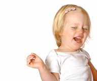 Toddler girl laughing out loud. Beautiful girl toddler laughing out loud and having fun, isolated on white Royalty Free Stock Image