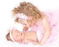 Free Toddler Girl Looking At Her Baby Sister Stock Photos - 25677703