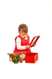 Toddler girl looking in Christmas gift Royalty Free Stock Photography