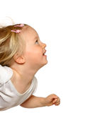 Toddler girl looking up Stock Photo