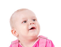 Toddler girl looking up. Happy Toddler girl looking up surprised isolated on white Stock Photo