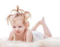 Toddler girl  lying in bed Royalty Free Stock Images