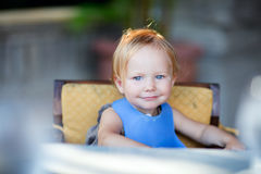 Toddler girl at mealtime Stock Image