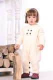 Toddler girl near woodpile Stock Photography
