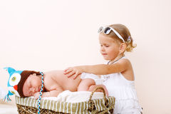 Toddler girl and newborn baby Stock Photos