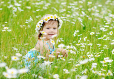 Toddler Girl On The Daisy Meadow Stock Photos