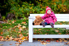 Toddler girl outdoors on autumn day Royalty Free Stock Photo