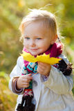 Toddler girl outdoors at autumn day stock image