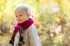 Toddler girl outdoors at autumn day Royalty Free Stock Image