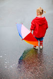Toddler girl outdoors at rainy day Stock Photography
