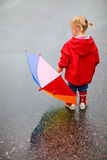 Toddler girl outdoors at rainy day Royalty Free Stock Photography