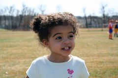 Toddler Girl Outside. Two year old girl outside at a soccer game Stock Image
