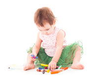 Toddler girl paints on the paper Royalty Free Stock Photography