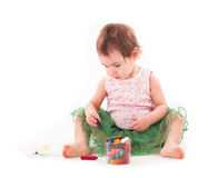 Toddler girl paints on the paper Stock Photography