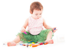 Toddler girl paints on the paper Royalty Free Stock Photos