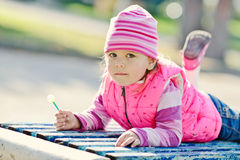 Toddler girl in the park Stock Image