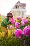 Toddler girl with peonys stock photography