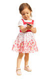 Toddler girl with phone mobile Stock Image