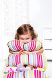 Toddler girl with pillows Stock Photo
