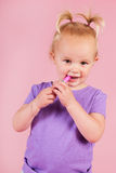 Toddler girl in pink with lipstick Stock Image