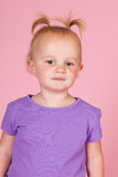 Toddler girl in pink. Portrait toddler girl on pink background royalty free stock images
