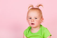 Toddler girl in pink Stock Images