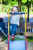 Toddler girl on the playground Stock Photo