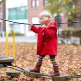 Toddler girl at playground Stock Photo