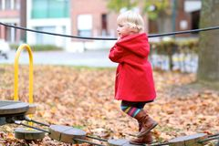 Toddler girl at playground Stock Image