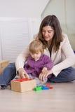 Toddler girl playing Royalty Free Stock Image