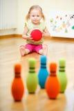 Toddler girl playing stock photography