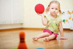 Toddler girl playing Royalty Free Stock Photo