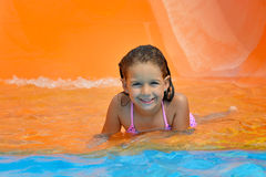 Toddler girl playing in aquapark Royalty Free Stock Images