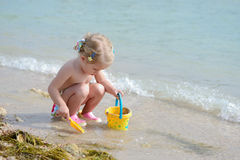 Toddler girl playing on the beach Royalty Free Stock Images