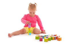 Toddler girl playing with blocks Royalty Free Stock Images