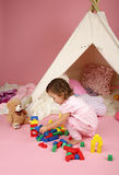 Toddler Girl Playing with BLocks and Toys Royalty Free Stock Images
