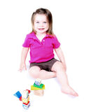 Toddler girl playing with childrens blocks. On white background Royalty Free Stock Images