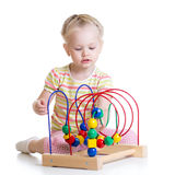 Toddler girl playing with colorful toy Stock Photos