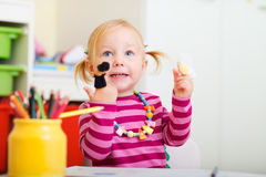 Toddler girl playing with finger puppets Royalty Free Stock Photos