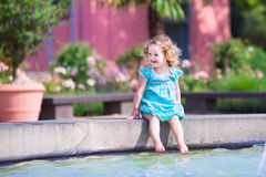 Toddler girl playing in a fountain Stock Photography