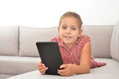 Toddler girl playing games on her tablet Royalty Free Stock Photo